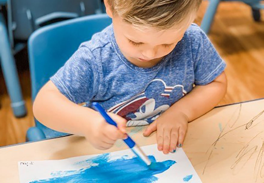cute boy drawing with markers at a Preschool & Daycare Serving Conway & Myrtle Beach, SC