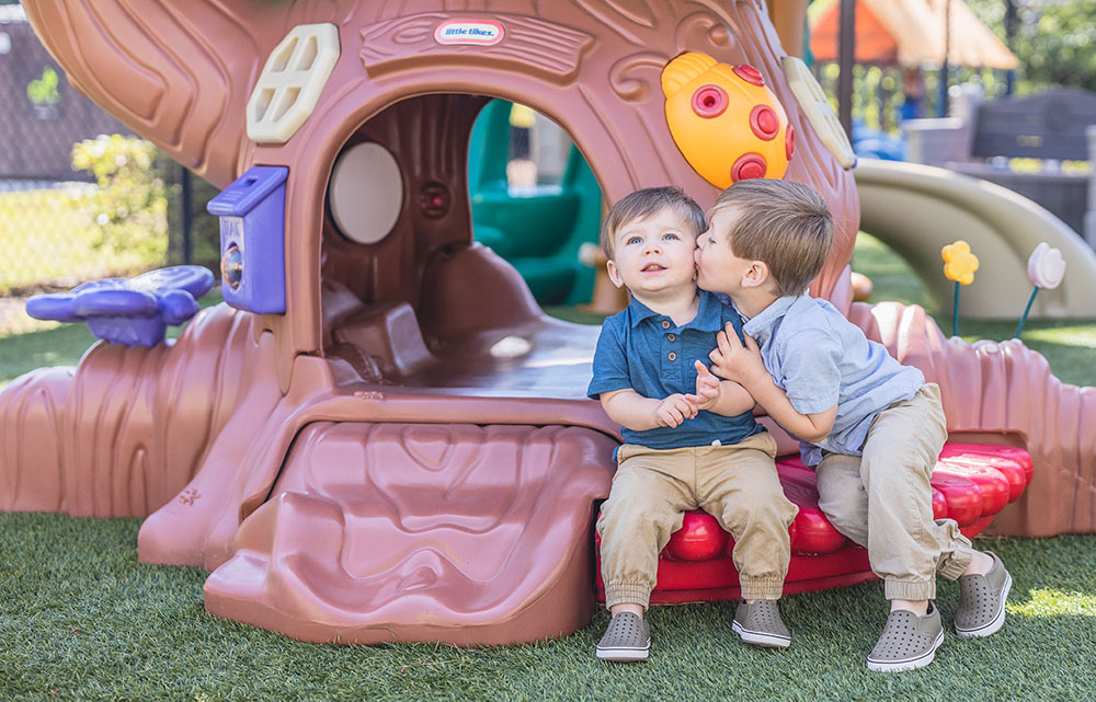happy boys playing outdoors at a Preschool & Daycare Serving Conway & Myrtle Beach, SC