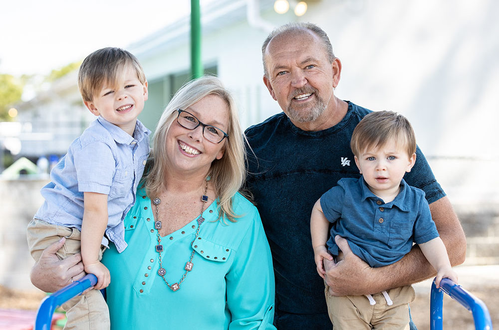 happy family smiling at a Preschool & Daycare Serving Conway & Myrtle Beach, SC