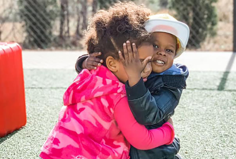 happy preschool girls hugging at a Preschool & Daycare Serving Conway & Myrtle Beach, SC