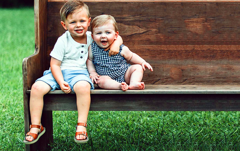 two cute boys sitting outside at a Preschool & Daycare Serving Conway & Myrtle Beach, SC