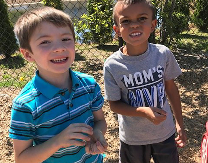 two preschool boys smiling outside at a Preschool & Daycare Serving Conway & Myrtle Beach, SC