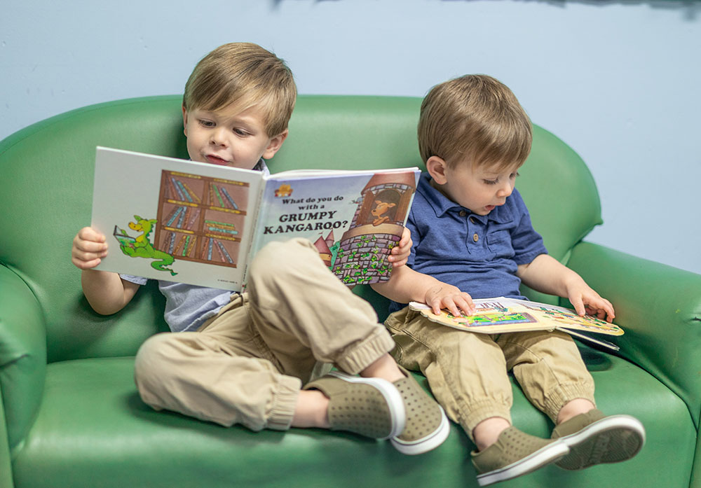 young boys reading a book at a Preschool & Daycare Serving Conway & Myrtle Beach, SC