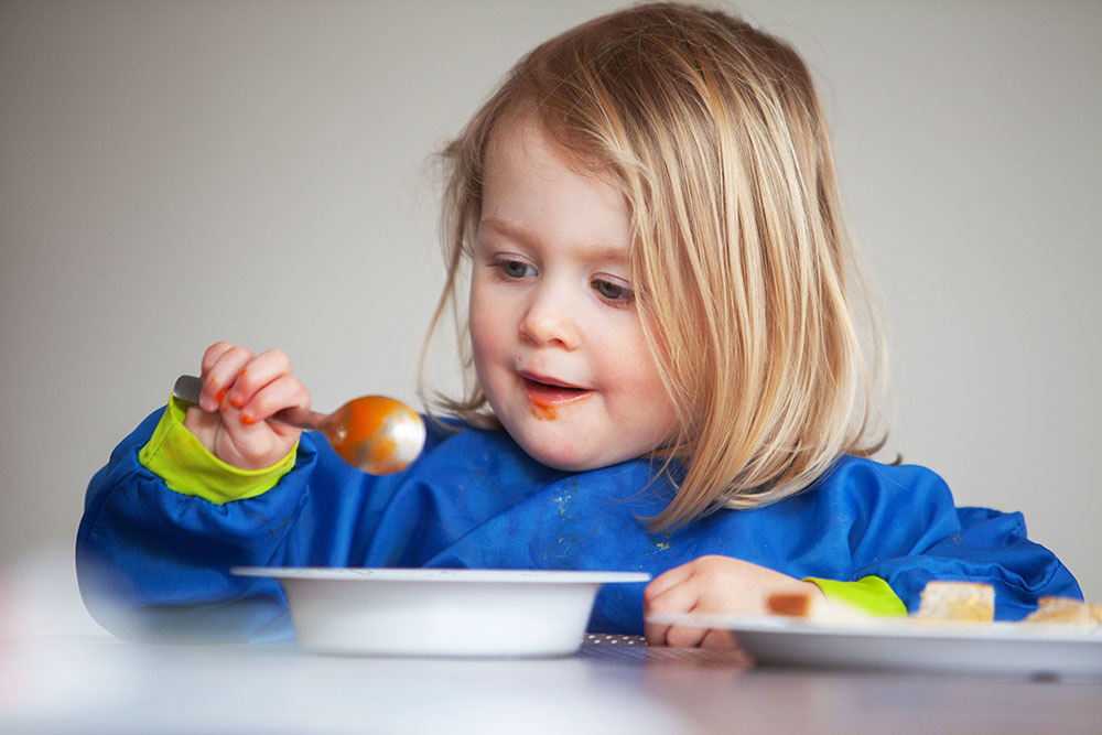 young girl eating tomato soup at a Preschool & Daycare Serving Conway & Myrtle Beach, SC
