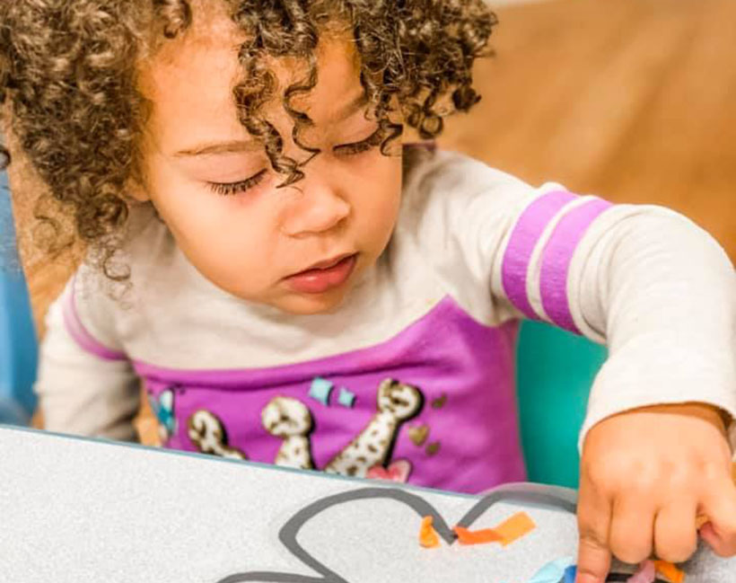 cute toddler finger painting at a Preschool & Daycare Childcare Center serving Conway & Myrtle Beach, SC